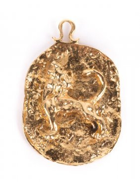 A Leo Charm In 14k Yellow Gold