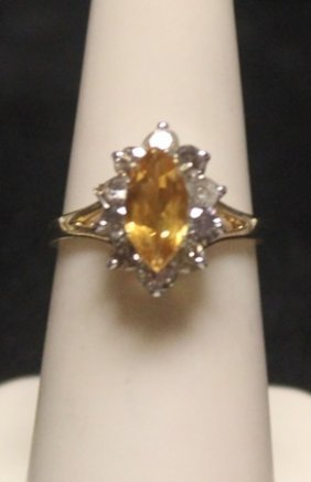 Fancy 14 Kt Golden Sapphire With Diamonds Ring.