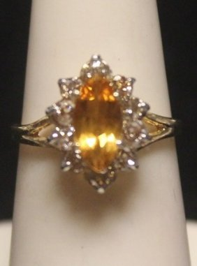 Beautiful 14 Kt Golden Sapphire With Diamonds Ring