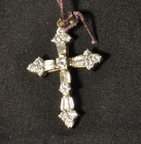 A NEW STAMPED 14KT YELLOW GOLD DIAMOND CROSS