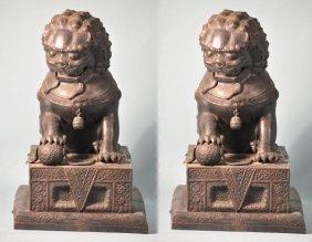 PAIR OF ANTIQUE BRONZE REPOUSSE FOO LIONS