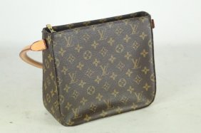 Louis Vuitton Monogram Canvas Bag With Camel Handle.