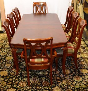 Cherry Finish Carved Dr Table With Two Leafs And Pads,
