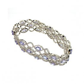 APP: 56k 14kt Gold 12CT Tanzanite Diamond Bracelet