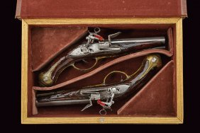 A Book-cased Pair Of Roman Style Flintlock Pistols