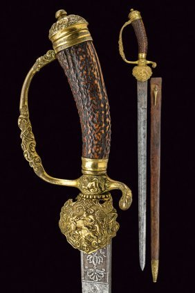 A Fine Hunting Hanger With Scabbard