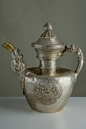 A Chiselled Silver Teapot