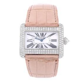Cartier - A Tank Divan Wrist Watch. Stainless Steel