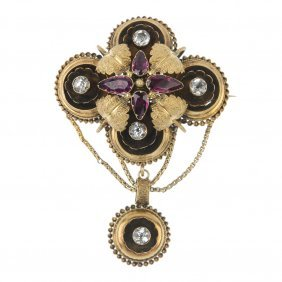 A Mid 19th Century Gold, Garnet And Paste Brooch.
