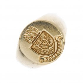 An 18ct Gold Signet Ring.