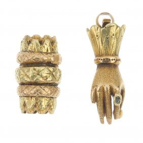 A Mid 19th Century Gold Hand Clasp And A Bead.