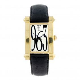 Theo Fennell - A Gentleman's Anglo Wrist Watch. 18ct