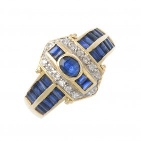 A Sapphire And Diamond Ring. The Oval-shape Sapphire