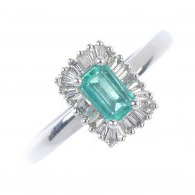 A Platinum Emerald And Diamond Cluster Ring. The