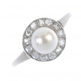 A Cultured Pearl And Diamond Cluster Ring. The Cultured