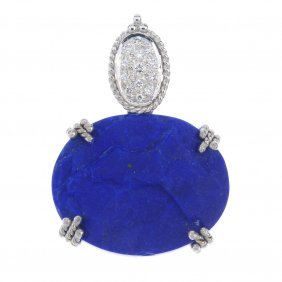 A Lapis Lazuli And Diamond Pendant. The Oval-shape