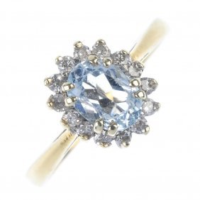 An 18ct Gold Aquamarine And Diamond Ring. The
