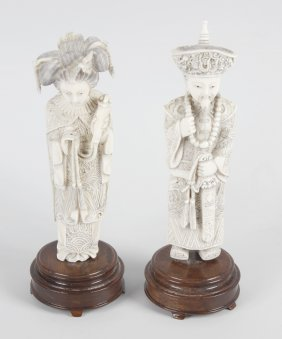 A Pair Of Carved Ivory Figures, Modelled As A Mandarin