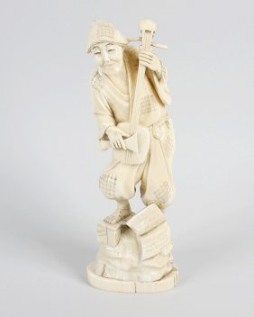 A Japanese Meiji Period Carved Ivory Okimono Modelled