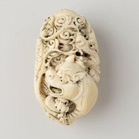 An Unusual Japanese Ivory Netsuke. Of Ovoid Form,