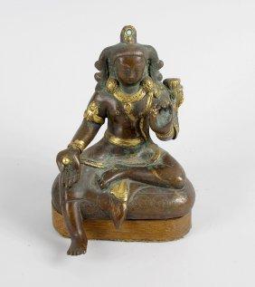 A South East Asian Parcel Gilt Bronze Figure, Modelled