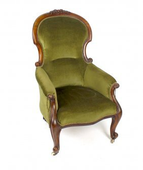 A Victorian Mahogany-framed Easy Chair. The Spoon Back