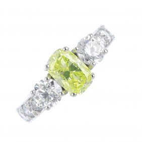 A Diamond And Coloured Diamond Three-stone Ring. The