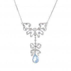 An Aquamarine And Diamond Necklace. The Pear-shape