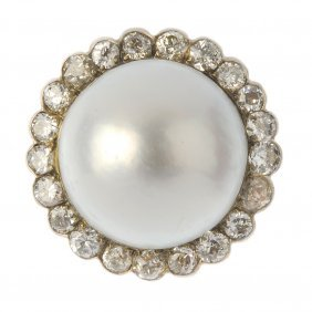 A Mabe Pearl And Diamond Cluster Ring. The Mabe Pearl,