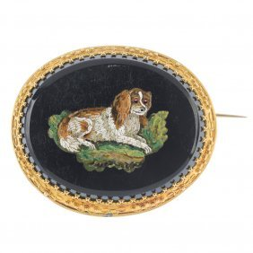 A Late 19th Century Gold Micro Mosaic Onyx Brooch.