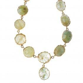 A Gem-set Necklace. The Oval Green Beryl Cabochon