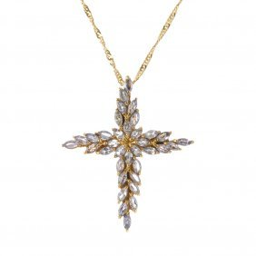 A 9ct Gold Tanzanite Cross Pendant, With Chain. The