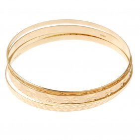 Four Bangles. Of Varied Widths And Patterns. Foreign
