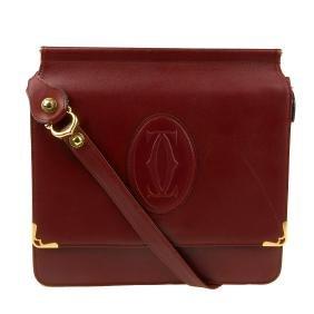 Cartier - A Reversible Bordeaux Messenger Handbag. With