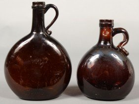 Two Deep Amber Handled Chestnut Flasks, Concave Ba