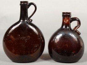 Two Deep Amber Handled Chestnut Flasks, Concave Ba
