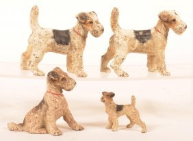 4 Hubley Wire Haired Fox Terrier Dog Figures.