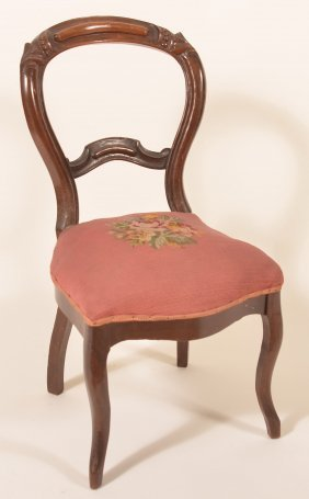Victorian Walnut Carved And Molded Side Chair.
