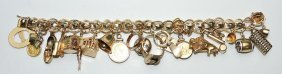 14kt Yellow Gold Charm Bracelet With 23 Charms