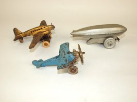 "Cast Iron ""lindy"" Airplane, Twa Tin Wind Up Airplane"
