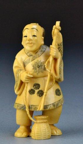 Japanese Carved Ivory Okimono Of A Fisherman