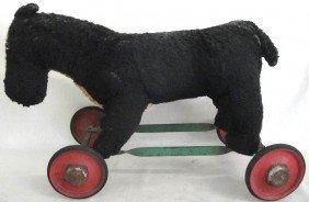 Stuffed Dog On Wheels.