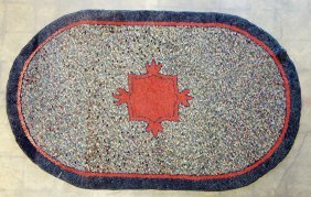 Sheared Oval Hooked Rug With Red Central Medallion -