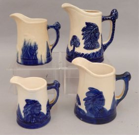 Four Sleepy Eye Pottery Pitchers