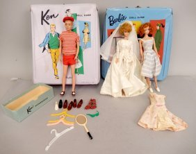 Barbie And Ken Dolls In Cases