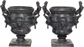 A Pair Of Egyptian Revival Patinated Bronze Urns