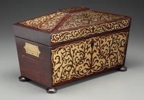 An English Regency Mahogany And Brass Tea Caddy,