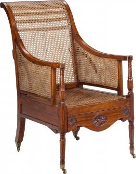 A George Iii Colonial Caned Convertible Armchair