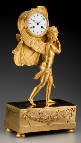 A French Empire Gilt Bronze Figural Mantel Clock