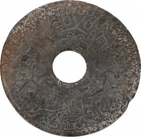 An Archaistic Jade Bi Disc 7-1/4 Inches Diameter